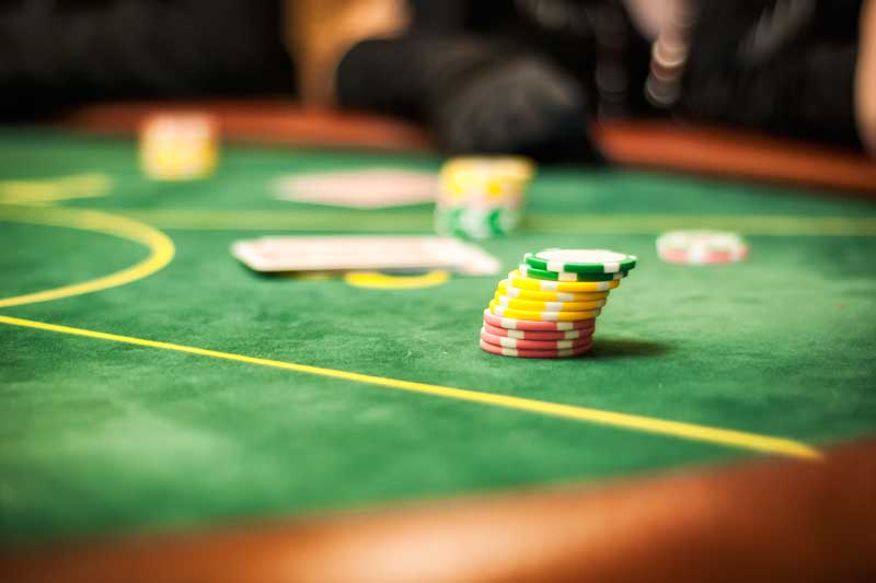 Betting chips on green table. Spread betting is not pure gambling': it is fully regulated by the Financial Conduct Authority (FCA) and if you know what you are doing, it's no more risky than share dealing.