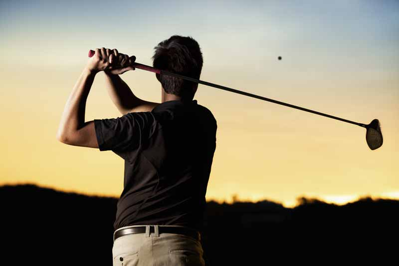 A golfer playing at sunset. When Tiger Woods wins a golf tournament, do you think it stops him practising, developing new techniques, learning from his experiences? The answer is no and the same should apply to your trading.